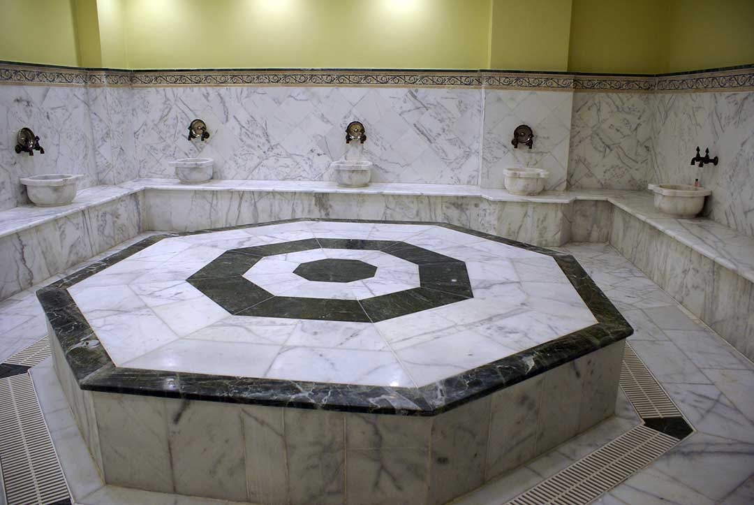 Turkish Bath hot room covered in marble with the hexagonal heating platform in the centre
