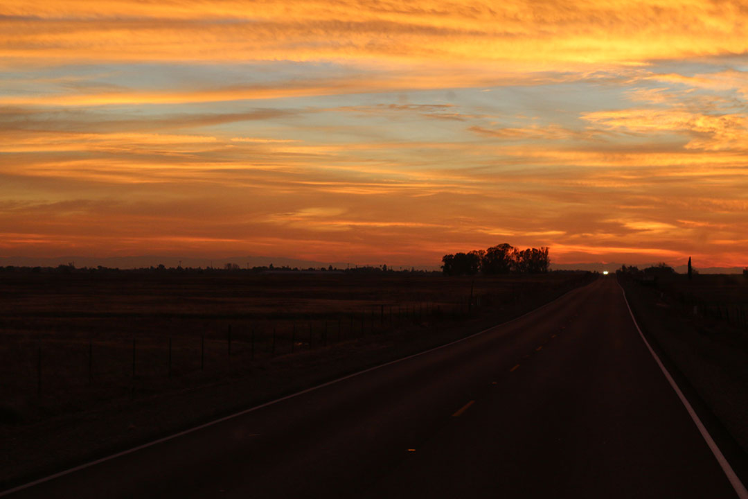 Beautiful orange sunset on the drive home from Yosemite National Park