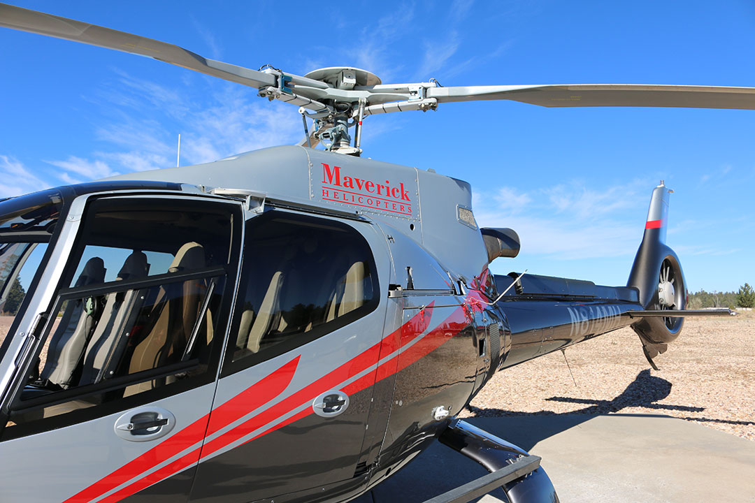 The Maverick Helicopter at the Grand Canyon on a bright blue sky day