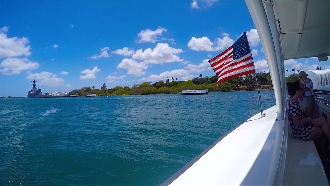 Sitting at the back of the ferry looking out over the ocean with the American flag blowing in the breeze as we leave Pearl Harbour Hawaii