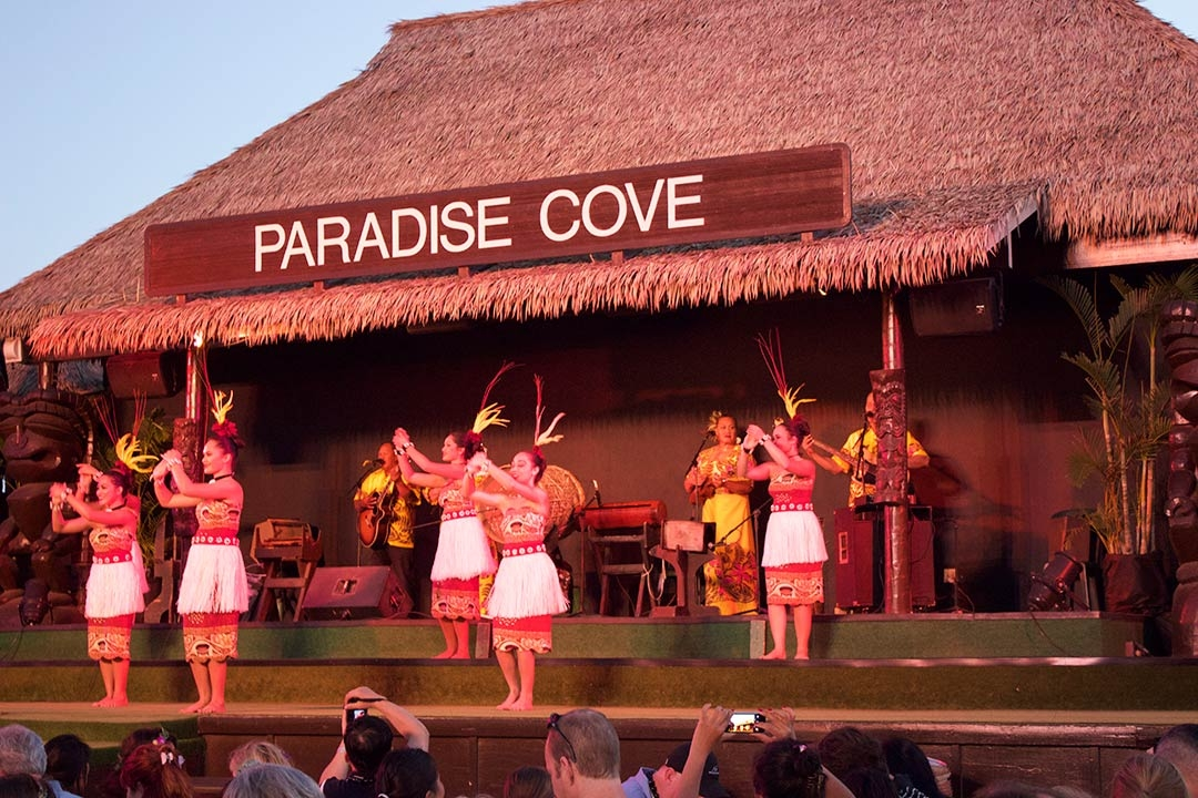 Female dancers performing on stage at sunset at the Paradise Cove Luau