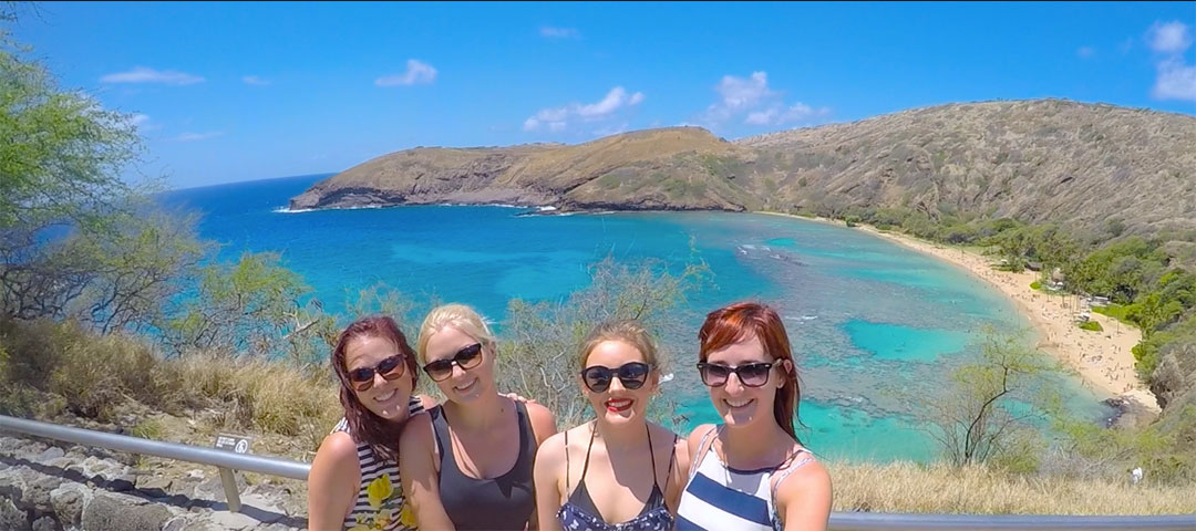 Selfie photo of 4 girls with beautiful Hanauma Bay in the background with its blue green water and mountains