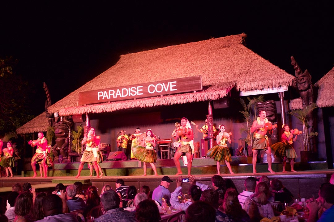 Female and male dancers performing on stage at sunset at the Paradise Cove Luau