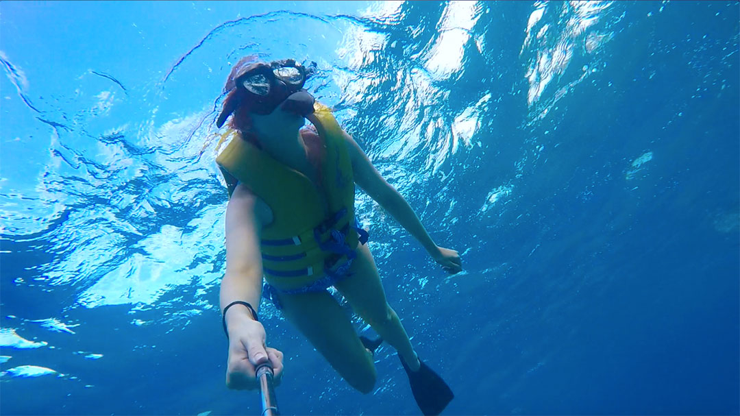 Me snorkelling in the ocean looking for wild dolphins and fish in Hawaii