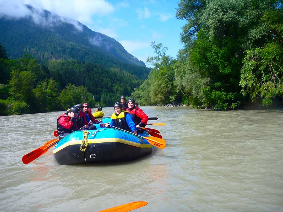 A group of white water rafters in their boat and ready to tackle the rapids in freezing temperatures in Austria