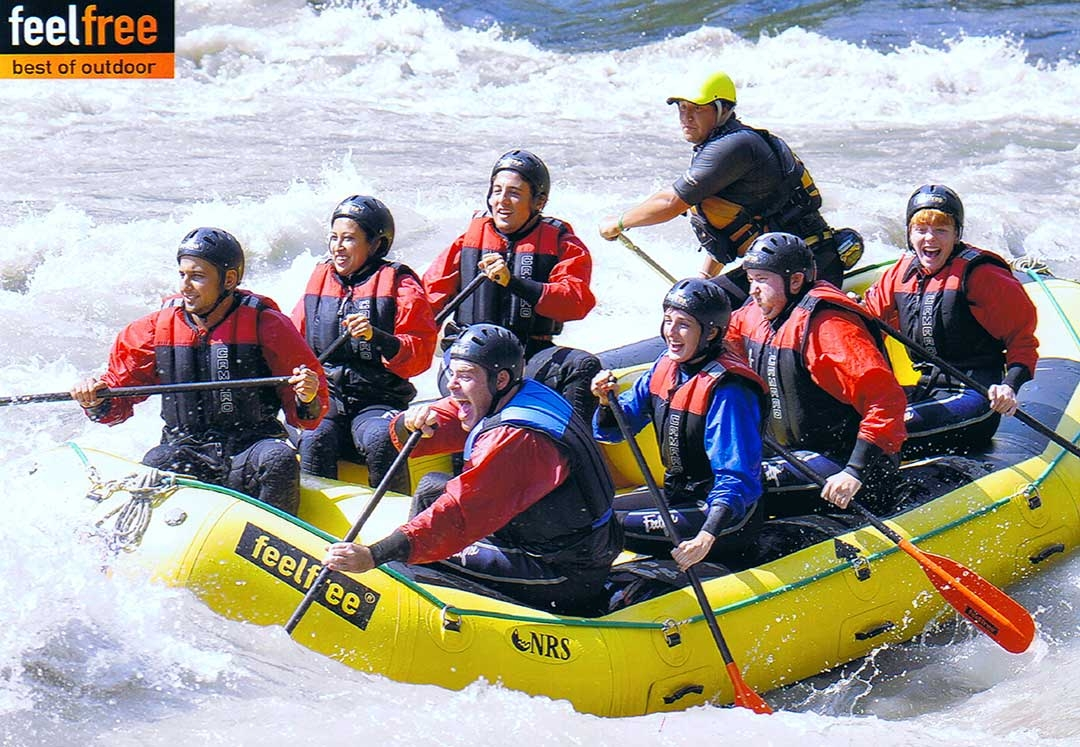 Professional image of my group smiling while white water rafting the rapid of Austria in freezing temperatures