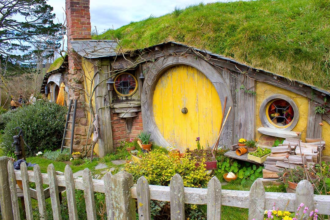 Little yellow hobbit house from Lord of the Rings in Hobbiton, Mata Mata New Zealand North Island