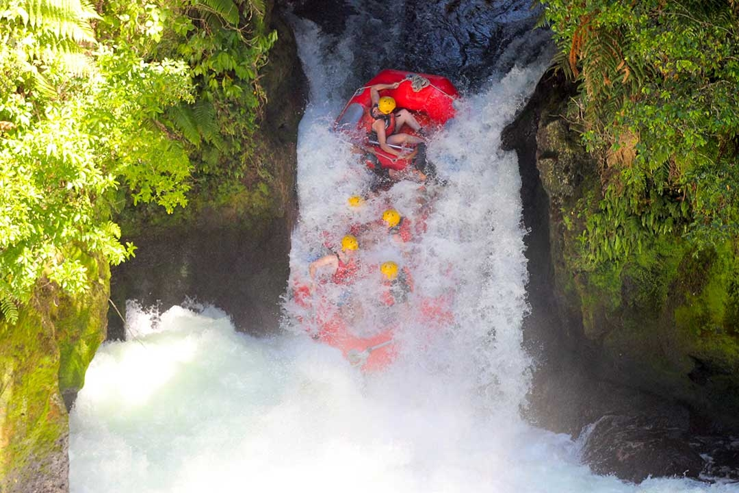 White water rafting mid way down the 7 metre highest commercially rafted waterfall in the world