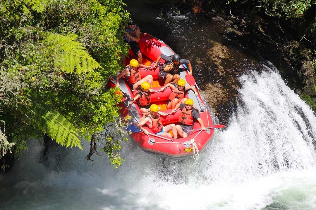 Mum and I with our group of white water rafters about to go over the edge of one of the waterfalls with everyone holding on tight