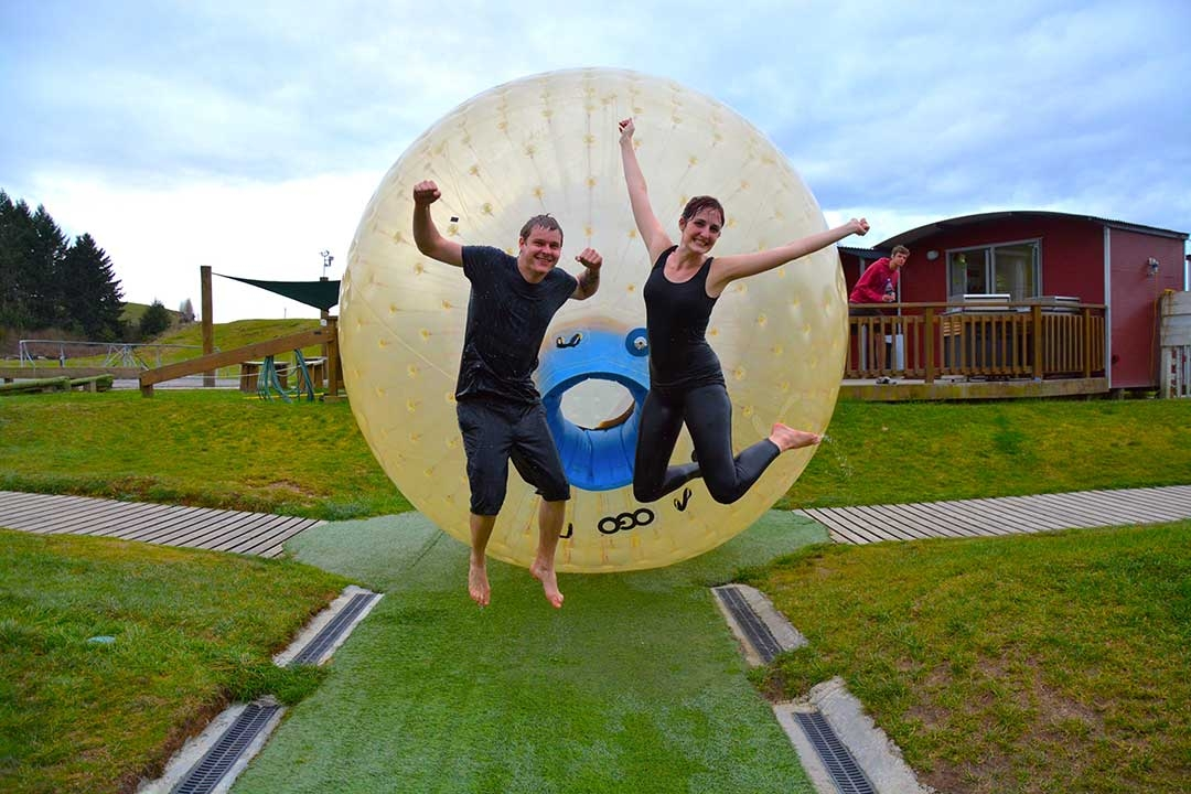 Casey and I jumping for joy in front of the OGO Sorbing ball on a cold winters day in Rotorua, New Zealand