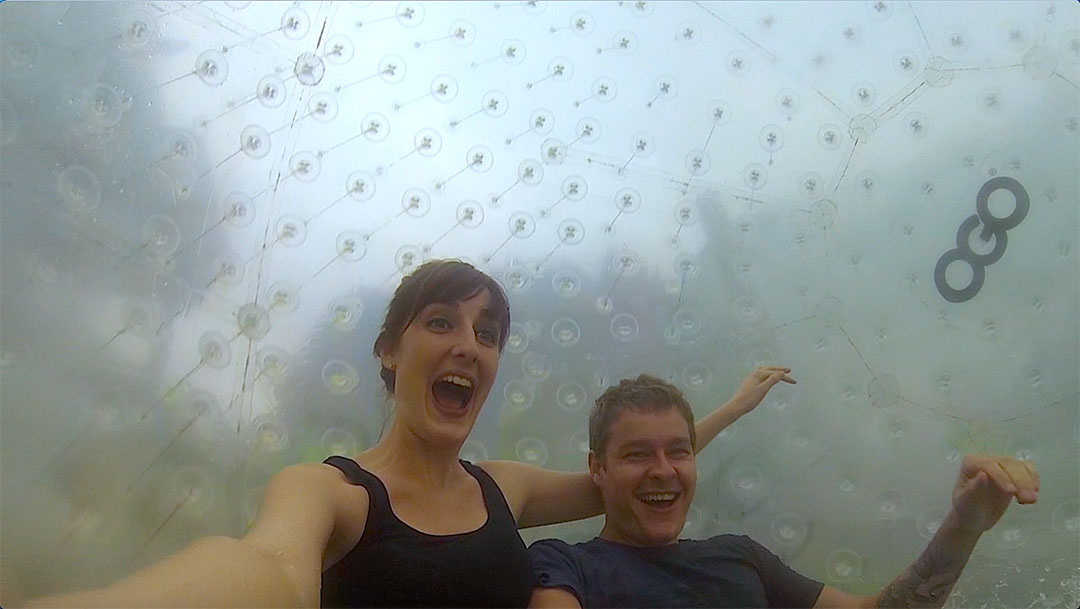 Casey and I inside the OGO Zorbing ball looking excited as speed pick up while we roll down the zigzag path on the hill