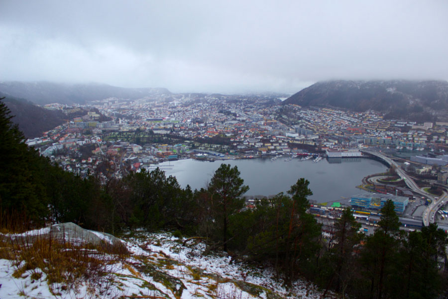 View of Bergen and the port from the top of the funicular, covered in snow on a cloudy winter day in Norway