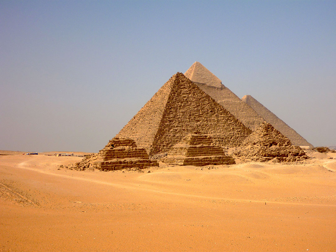 The Grand Pyramids of Giza in Egypt with a dusty blue summer's sky