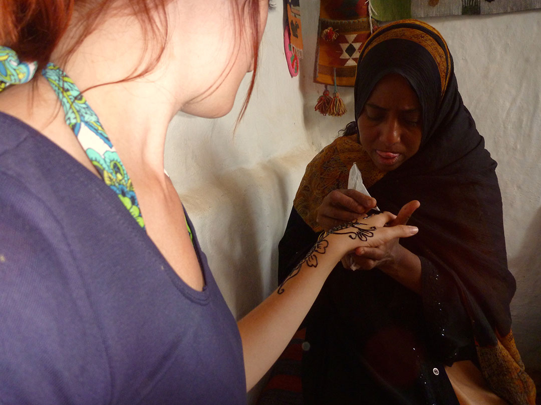 Henna hand painting by a local Nubian village woman inside her home