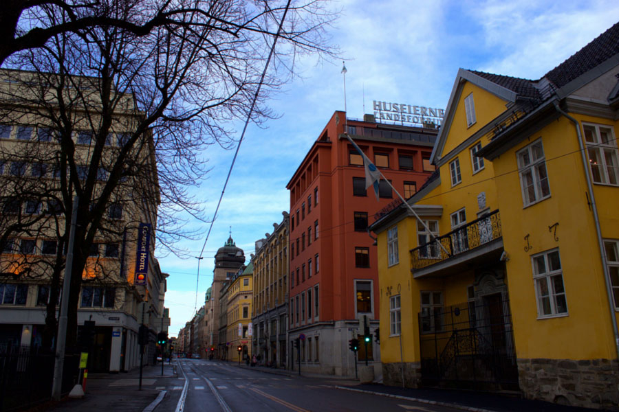 Walking the streets of Oslo, Norway on a beautiful winter day past bare trees and colourful buildings
