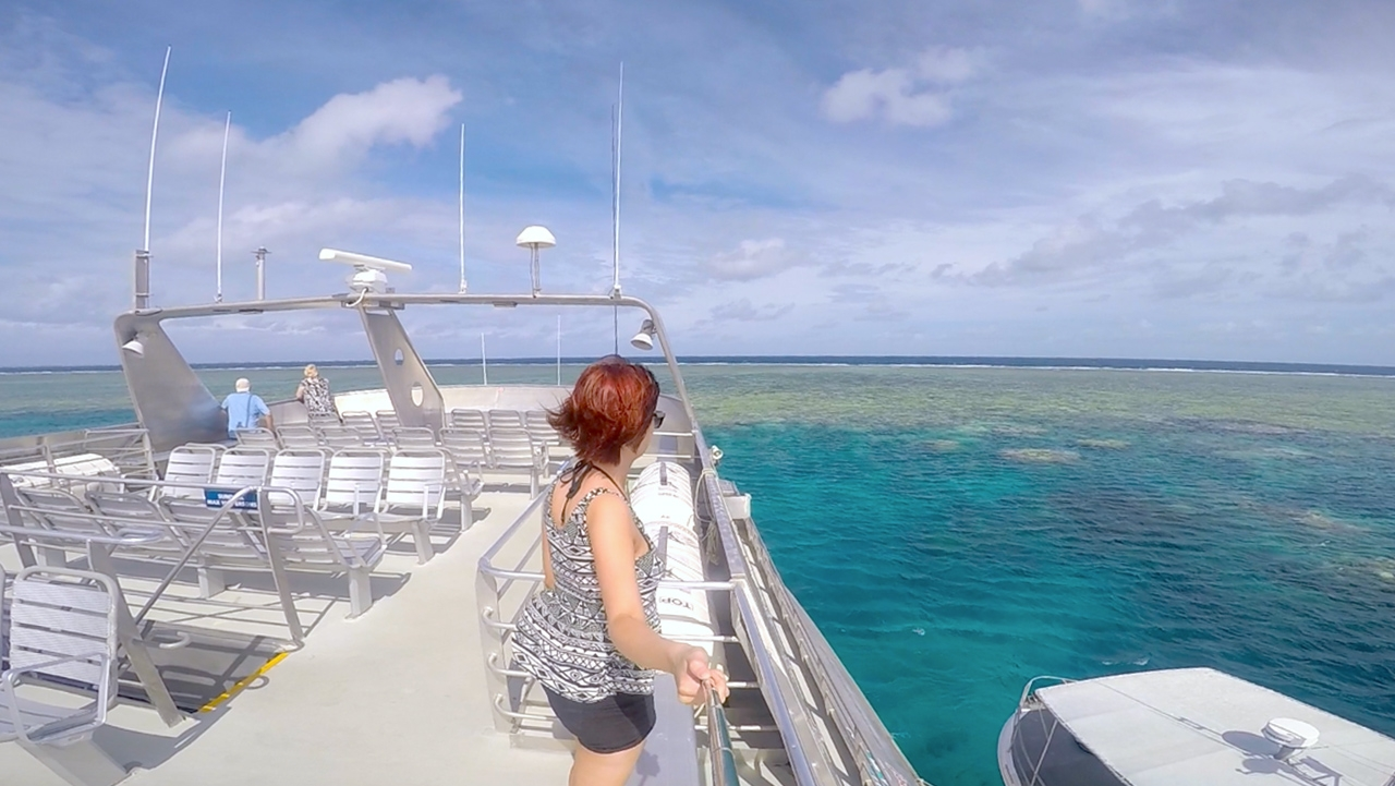 Me standing on the top level of the boat overlooking the coral of the Great Barrier Reef