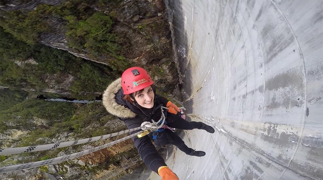 Looking down from above while I smile abseiling Gordon Dam