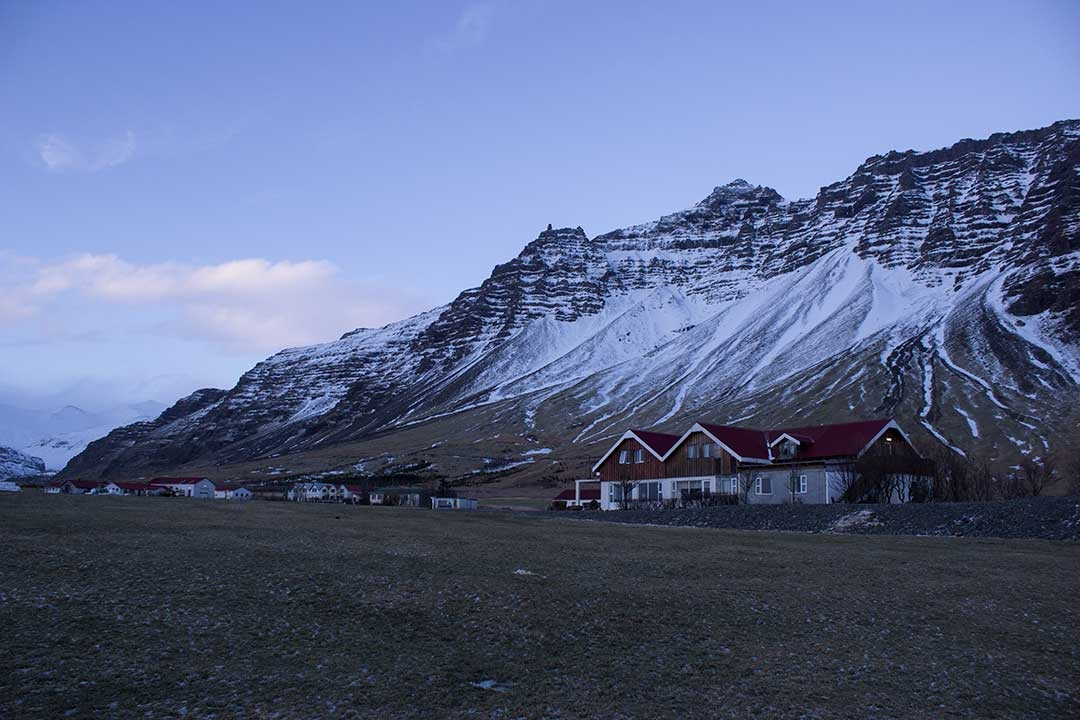Houses in Iceland during winter with mountains in the background