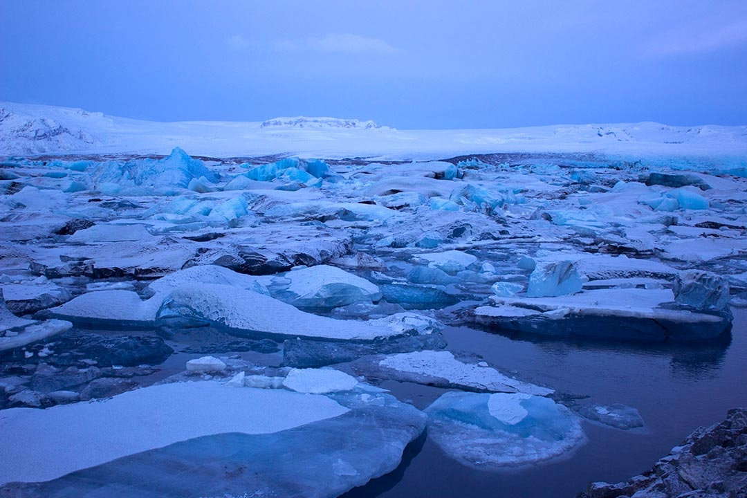 Jokulsarlon Glacier Lagoon at sunrise with blue icebergs