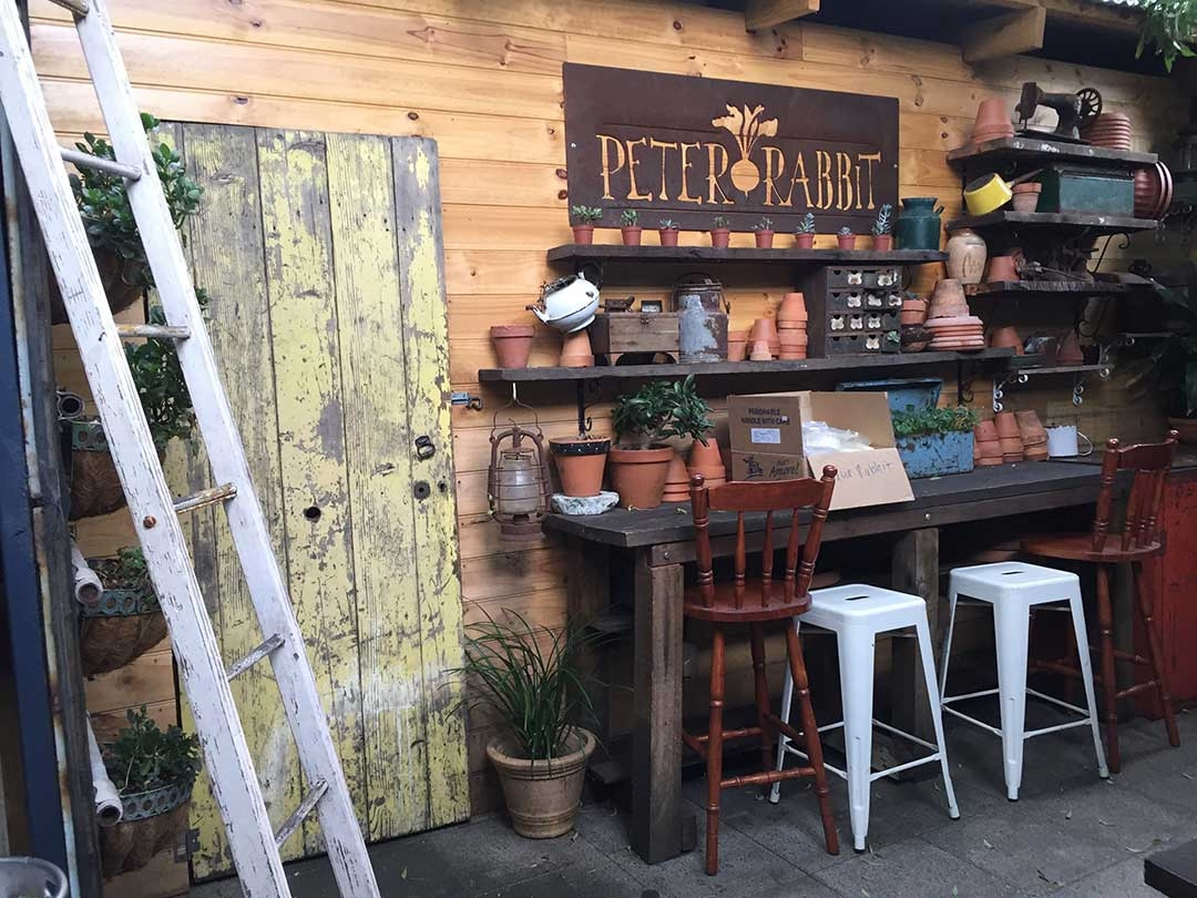 Quirky Peter Rabbit Cafe is set up with vintage doors and cute little decorations out the back
