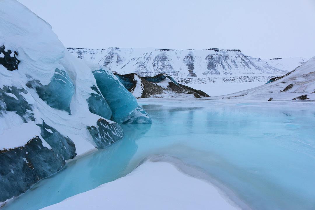 Blue frozen lakes in the Arctic in Svalbard